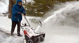 Woman using a snowblower with ergonomic control handle